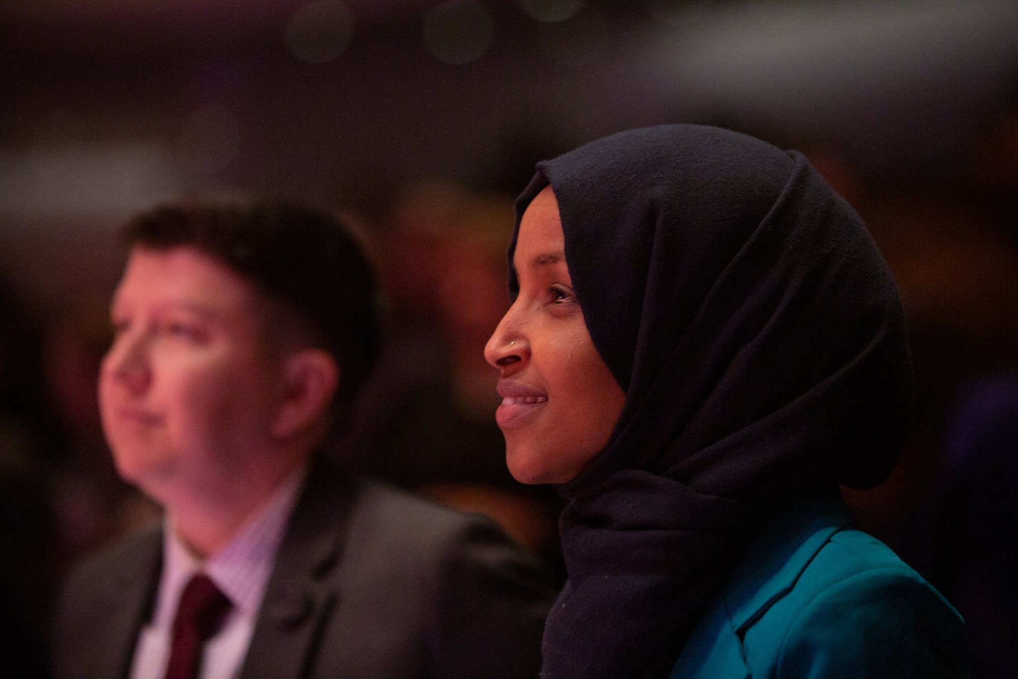 U.S. Rep. Ilhan Omar listens to keynote speaker Dr. Mae Jemison.