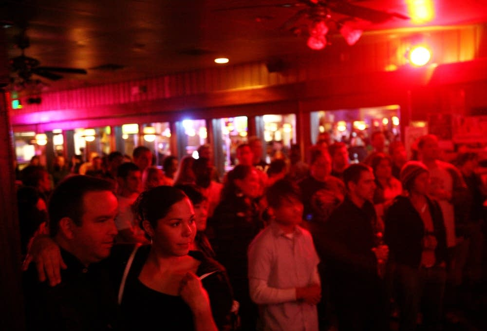 A crowd gathers at the Uptown Bar & Cafe