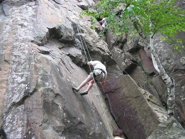 A climber rests in Interstate State Park.