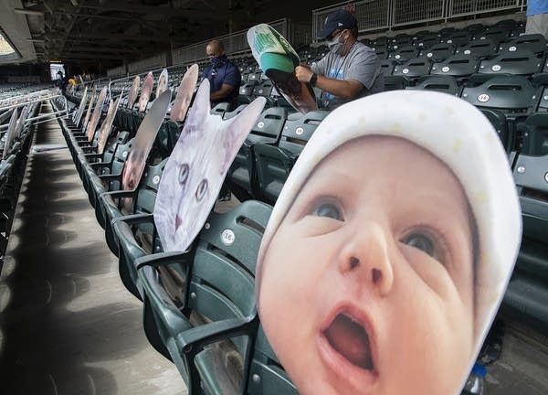 Large cutouts of babies and pets are placed in seats