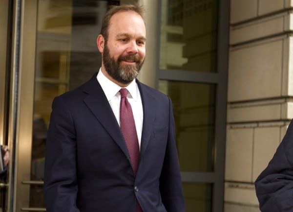 Rick Gates leaves federal court in Washington.