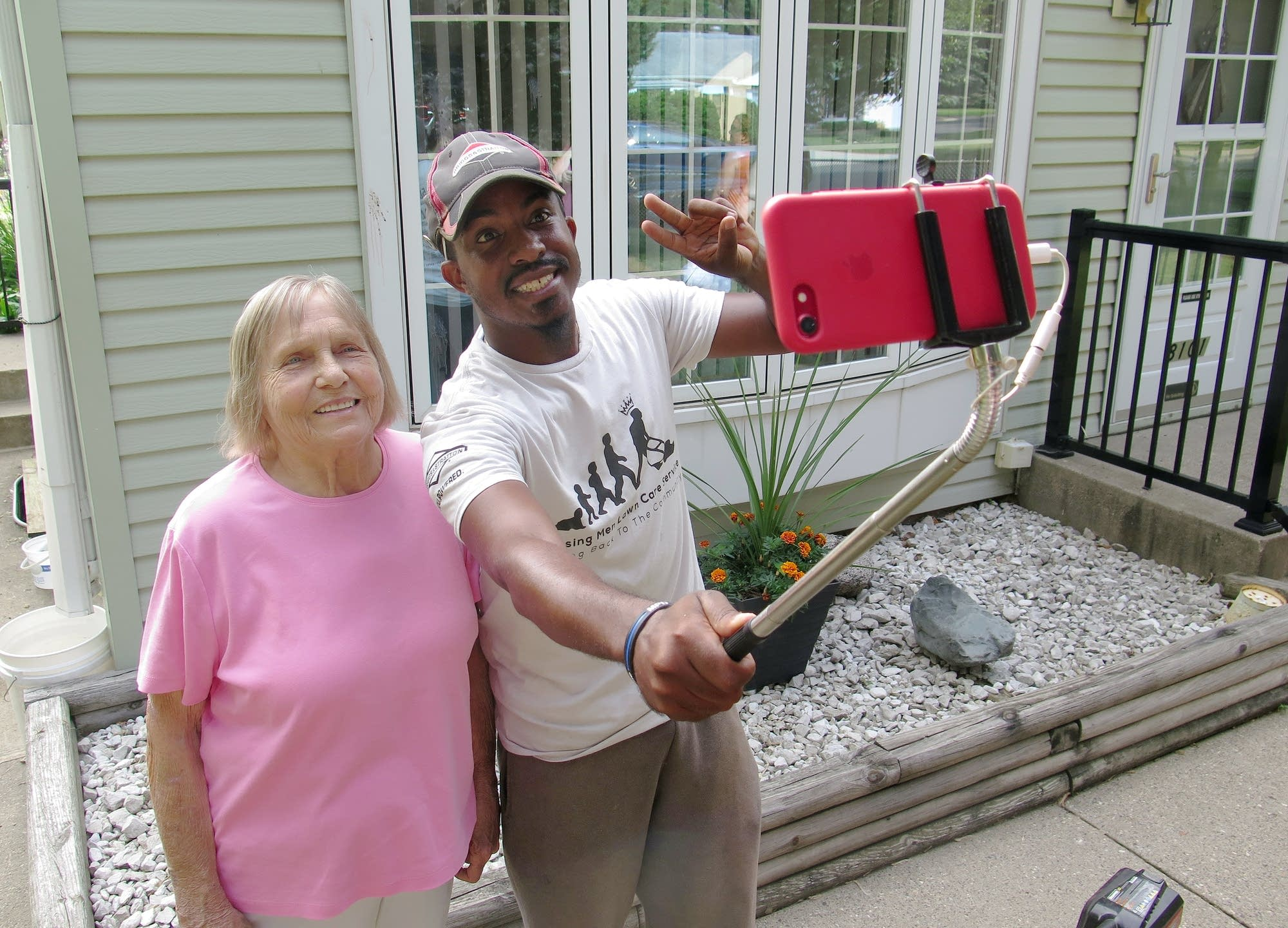 Charlene Frederick-Schrupp posed with Rodney Smith after he mowed her lawn.