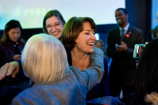 Sen. Amy Klobuchar hugs a supporter before taking the stage.