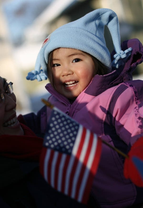 A child holds a flag during an inauguration event