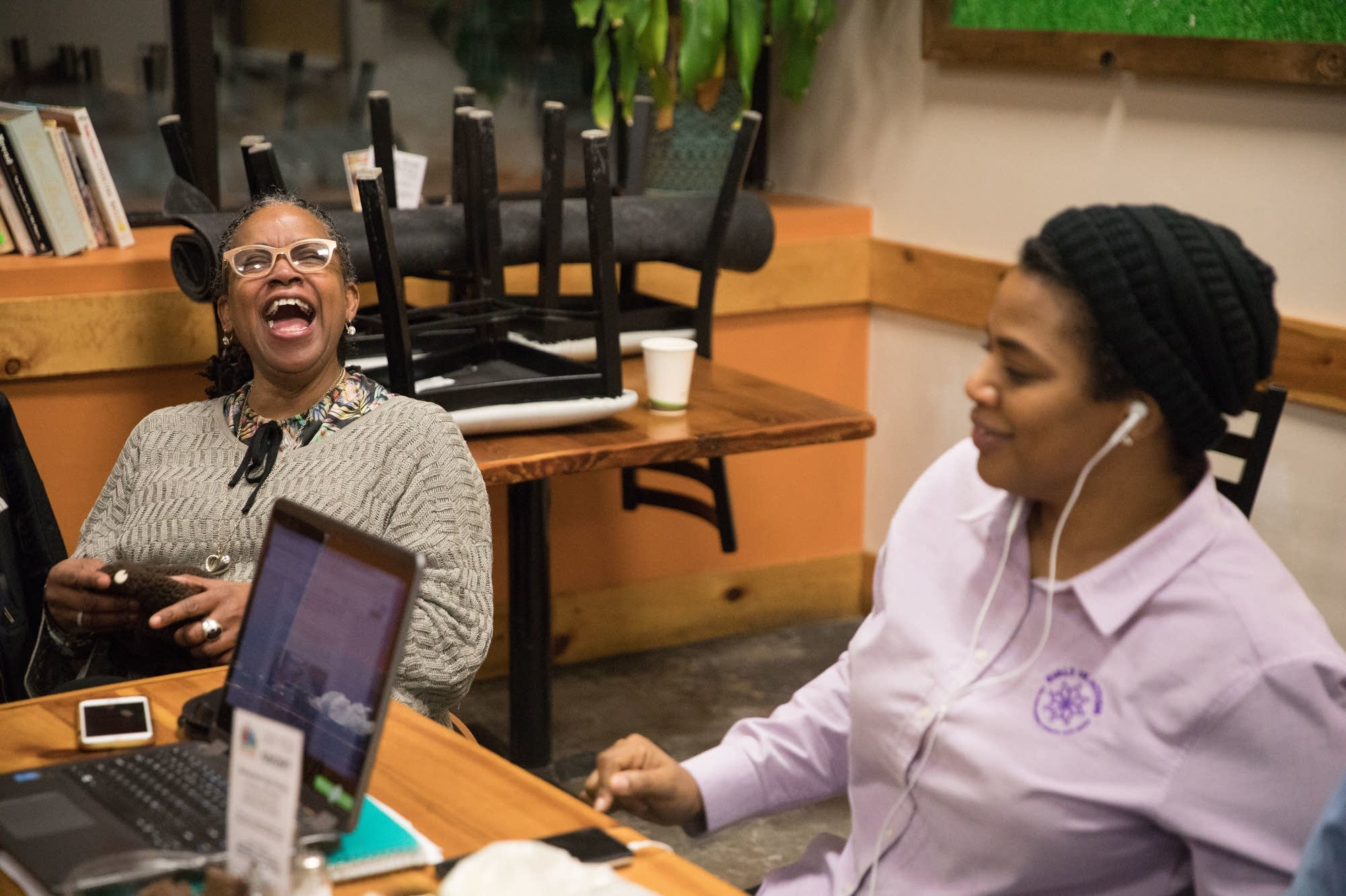 Tene Wells (left) and Nicole Pacini have a laugh together.