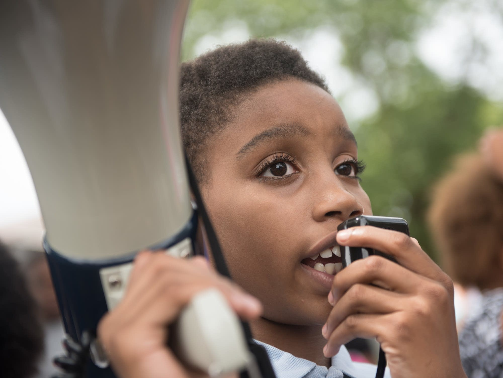 William Williams, 12, speaks on the megaphone.