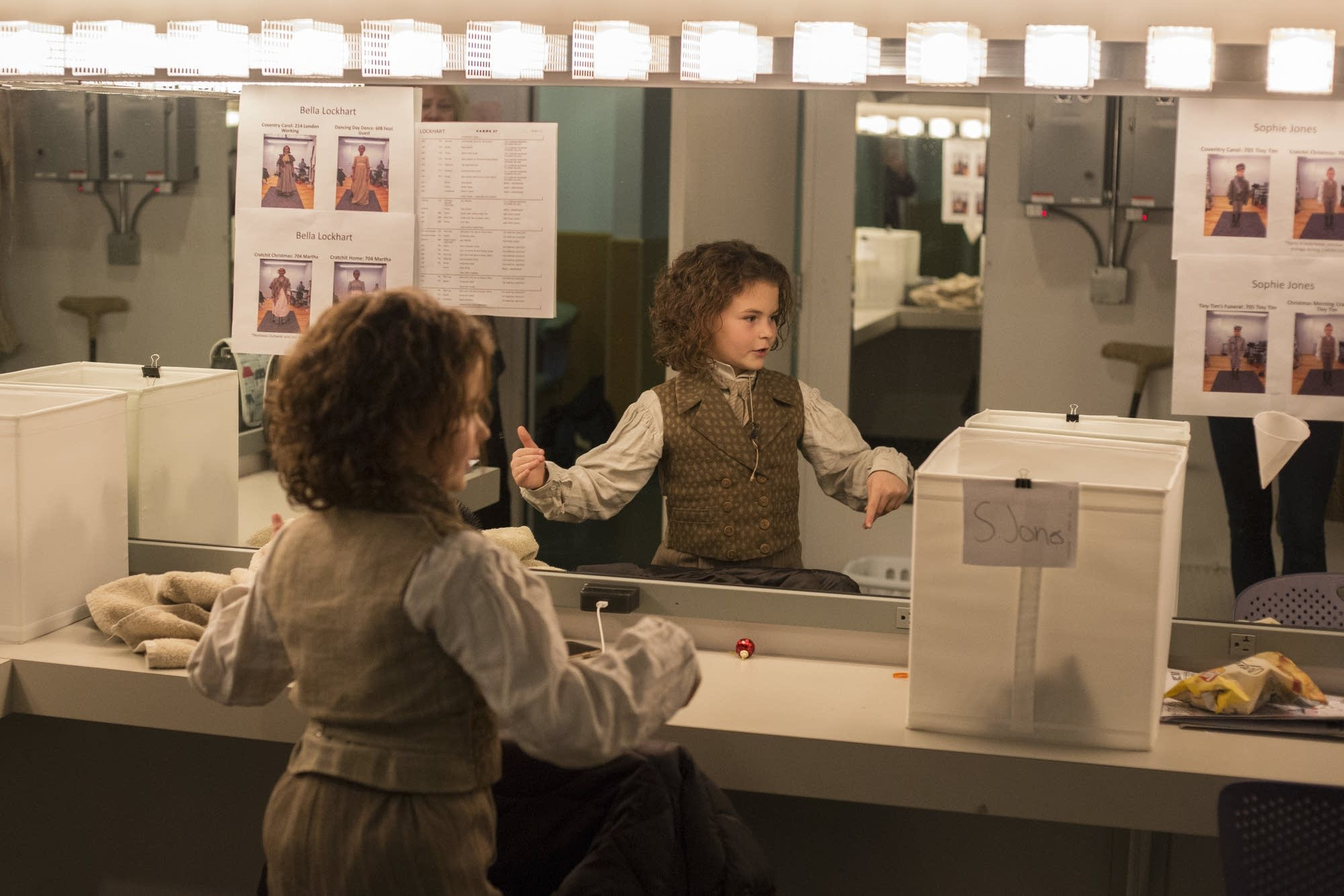 Sophie Jones dances around her dressing room while getting in costume.