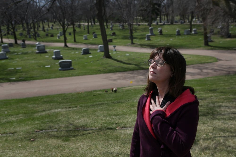 Lexi Reed Holtum paused near Steve Rummler's grave