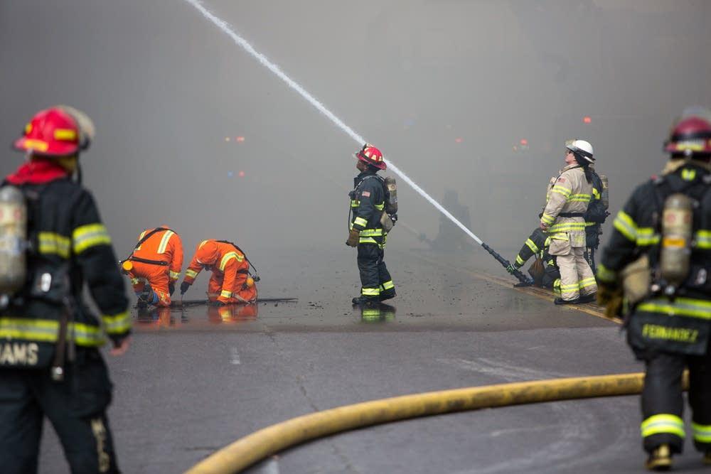 Crews hosed down buildings.