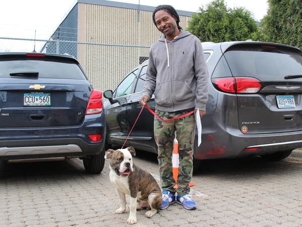 Ausar Lovestar and his Olde English bulldog, Horace.