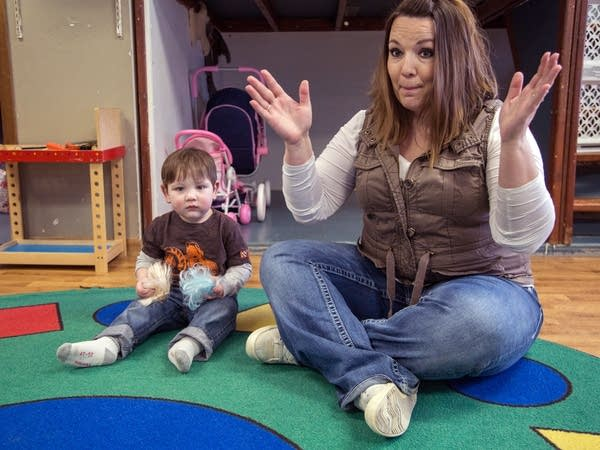 Amanda Theisen, owner of the Little Ducks Daycare, sings 'The Tiny Turtle.'