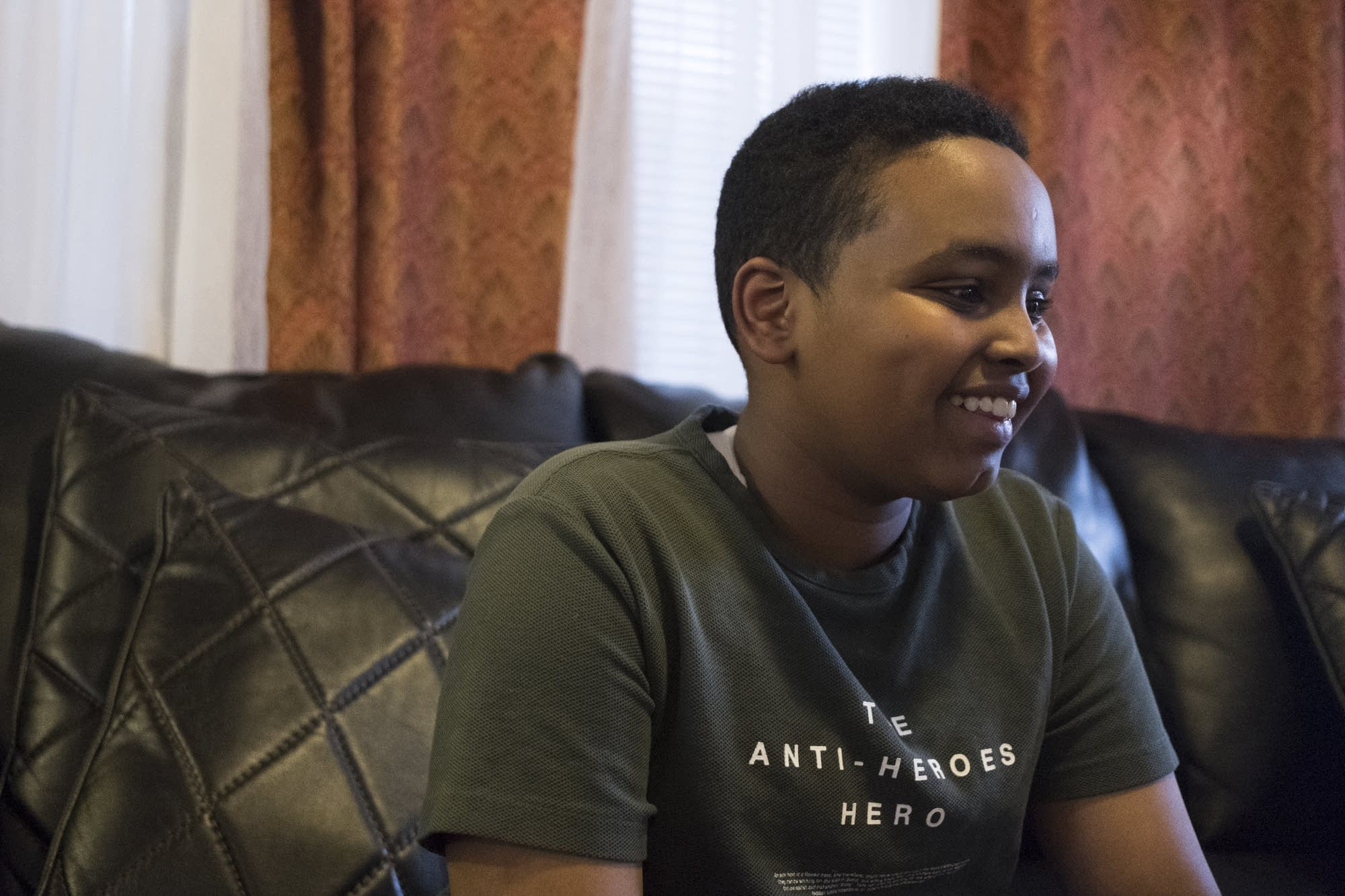 Fourteen-year-old Yusuf Dayur smiles during an interview