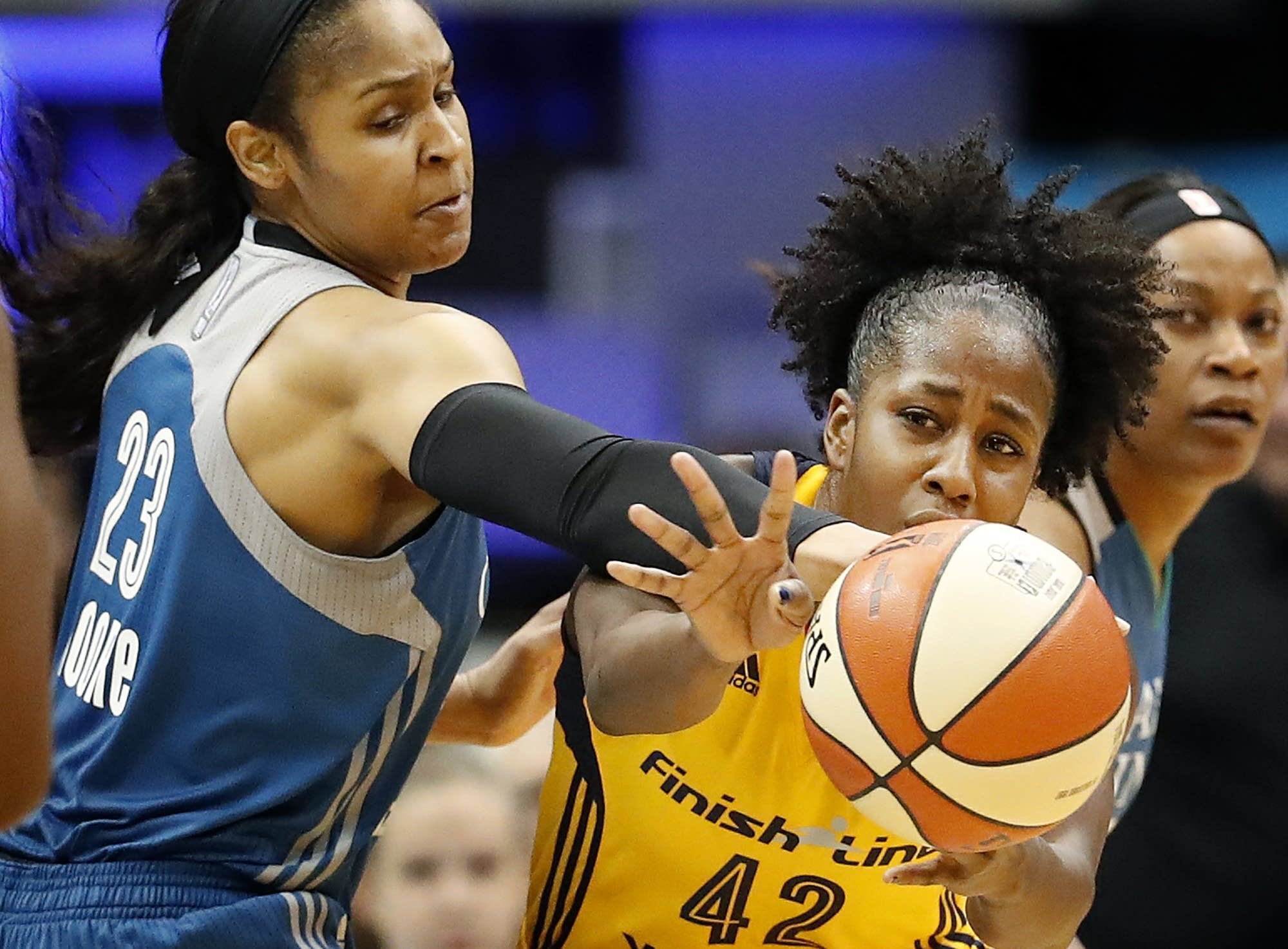 Maya Moore battles Indiana's Shenise Johnson.