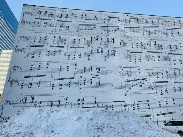 A mural of music notes on the side of a building.