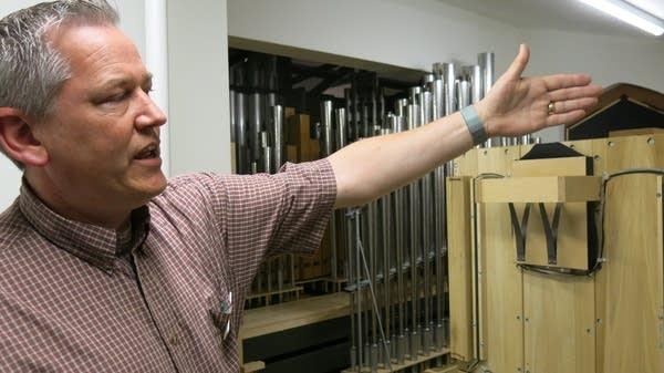 Pastor Corey Fuhrman walks through the custom pipe organ.