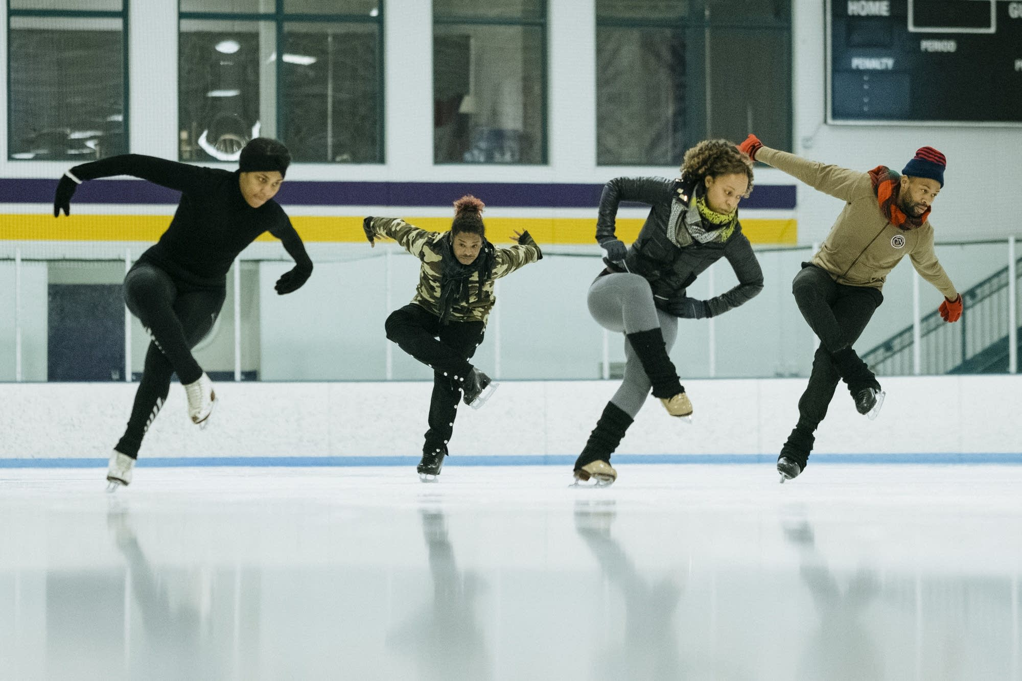 Brownbody skaters rehearse in unison.