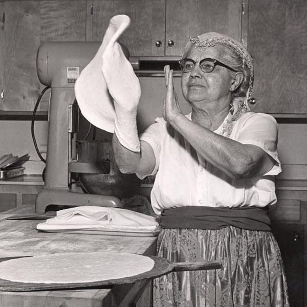 Helen George demonstrates making Syrian flat bread in 1964.