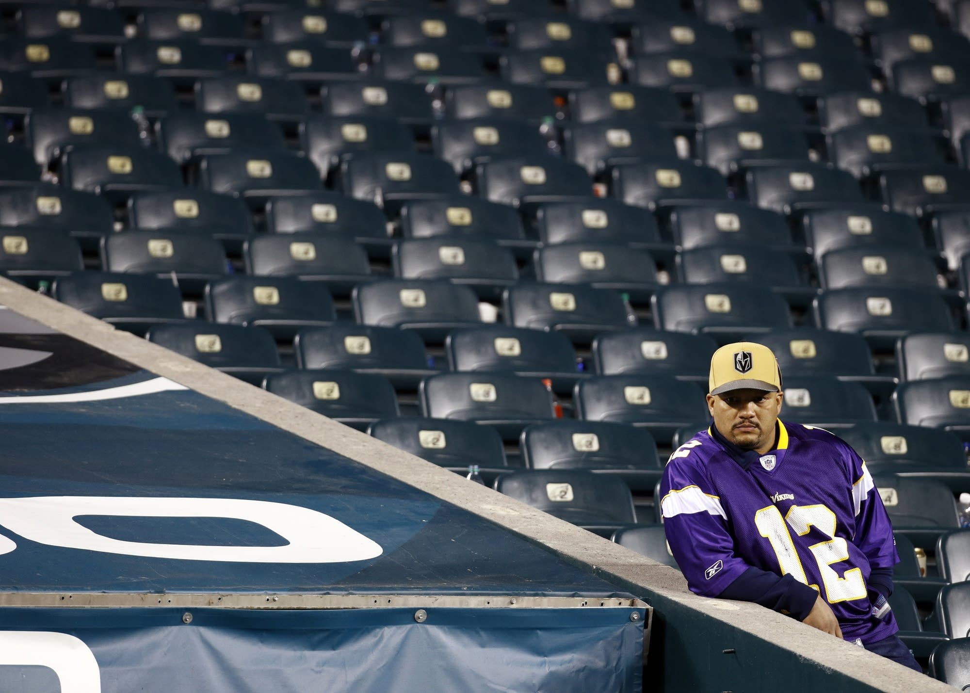 A Minnesota Vikings fan looks out after the NFC championship game.