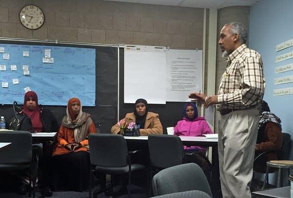 Mohamed Abass translates for Somali parents.