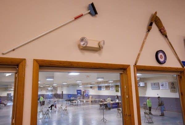 Curling equipment adorn the walls
