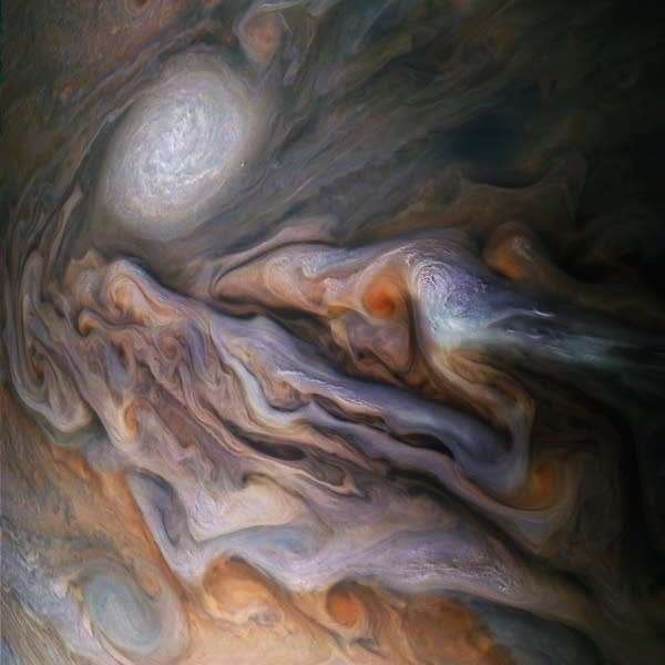 Swirling clouds in Jupiter's dynamic atmosphere