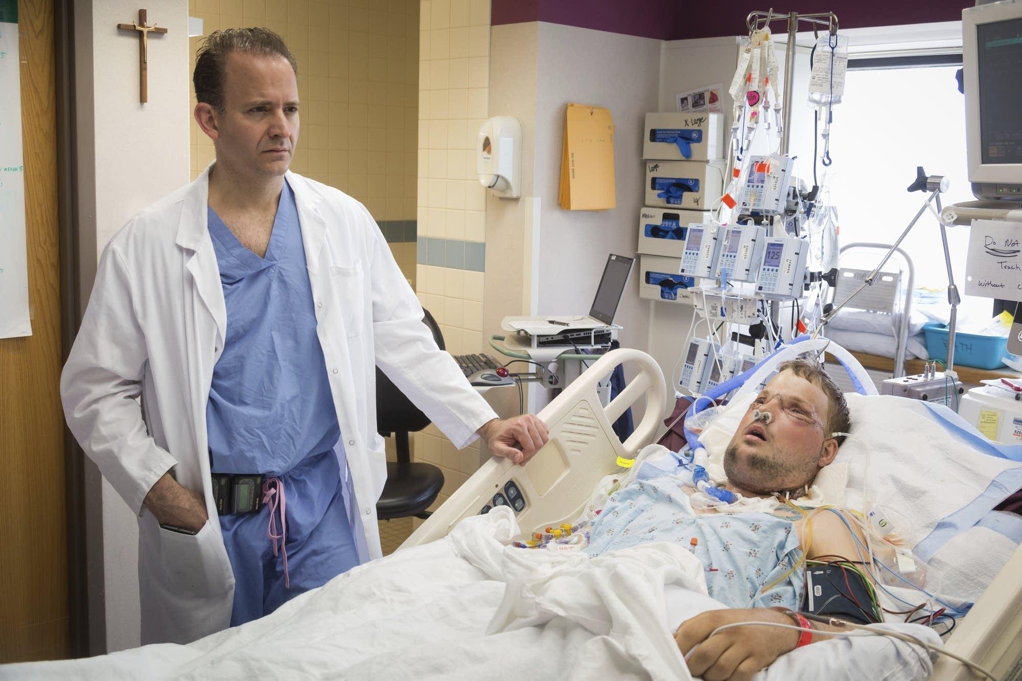 Dr. Samir Mardini checks on Andy Sandness