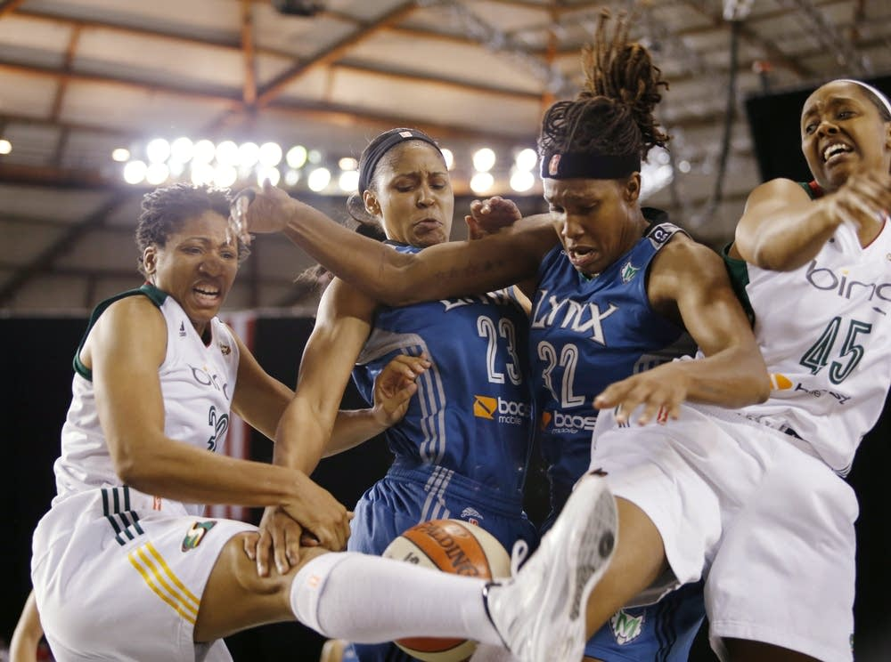 Tanisha Wright, Maya Moore, Rebekkah Brunson