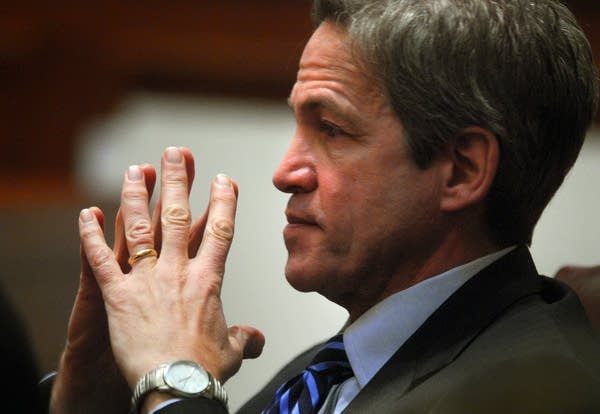 Norm Coleman listens to a witness testify