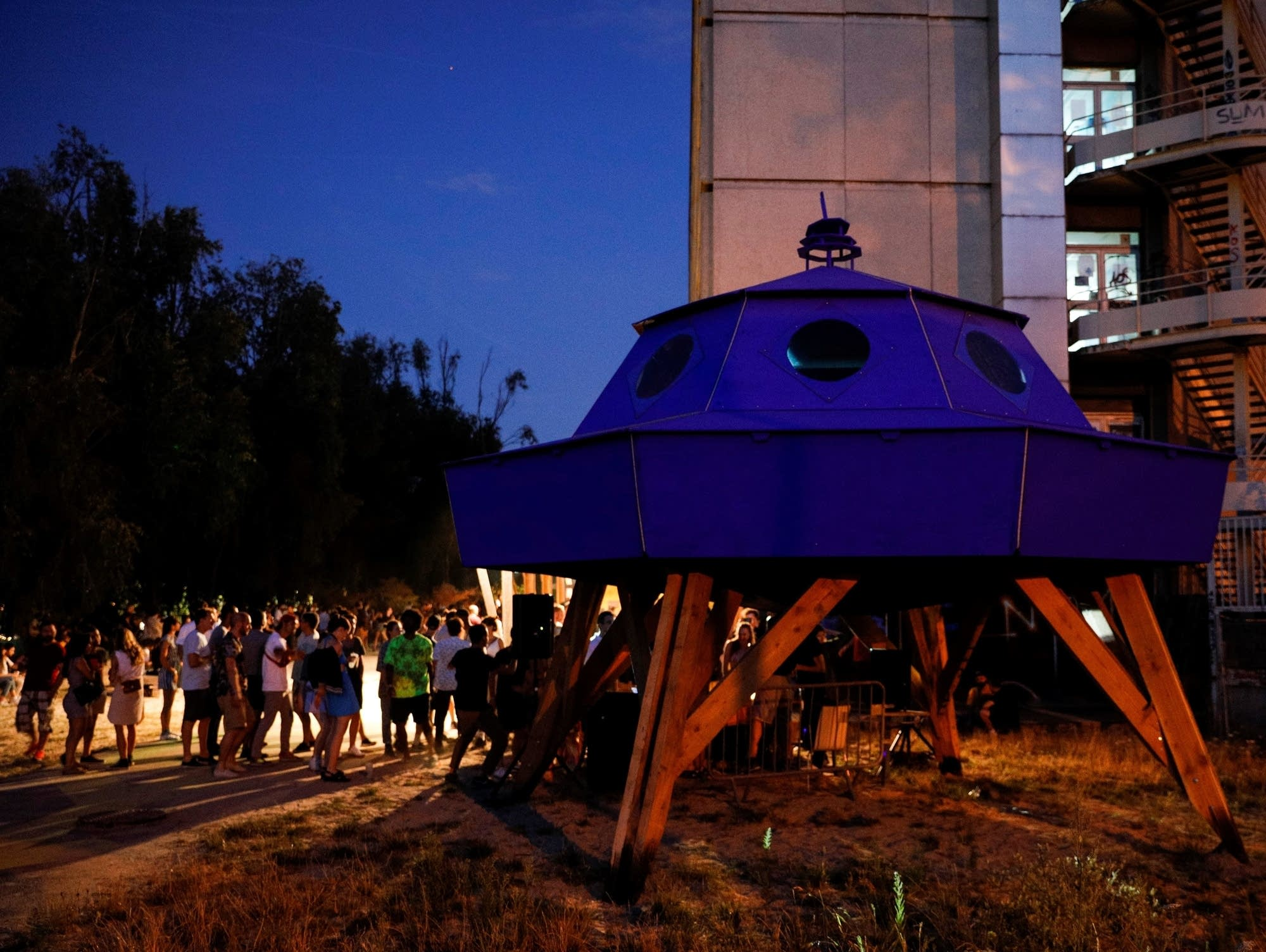 An illicit outdoor techno party near Paris, August 2020.