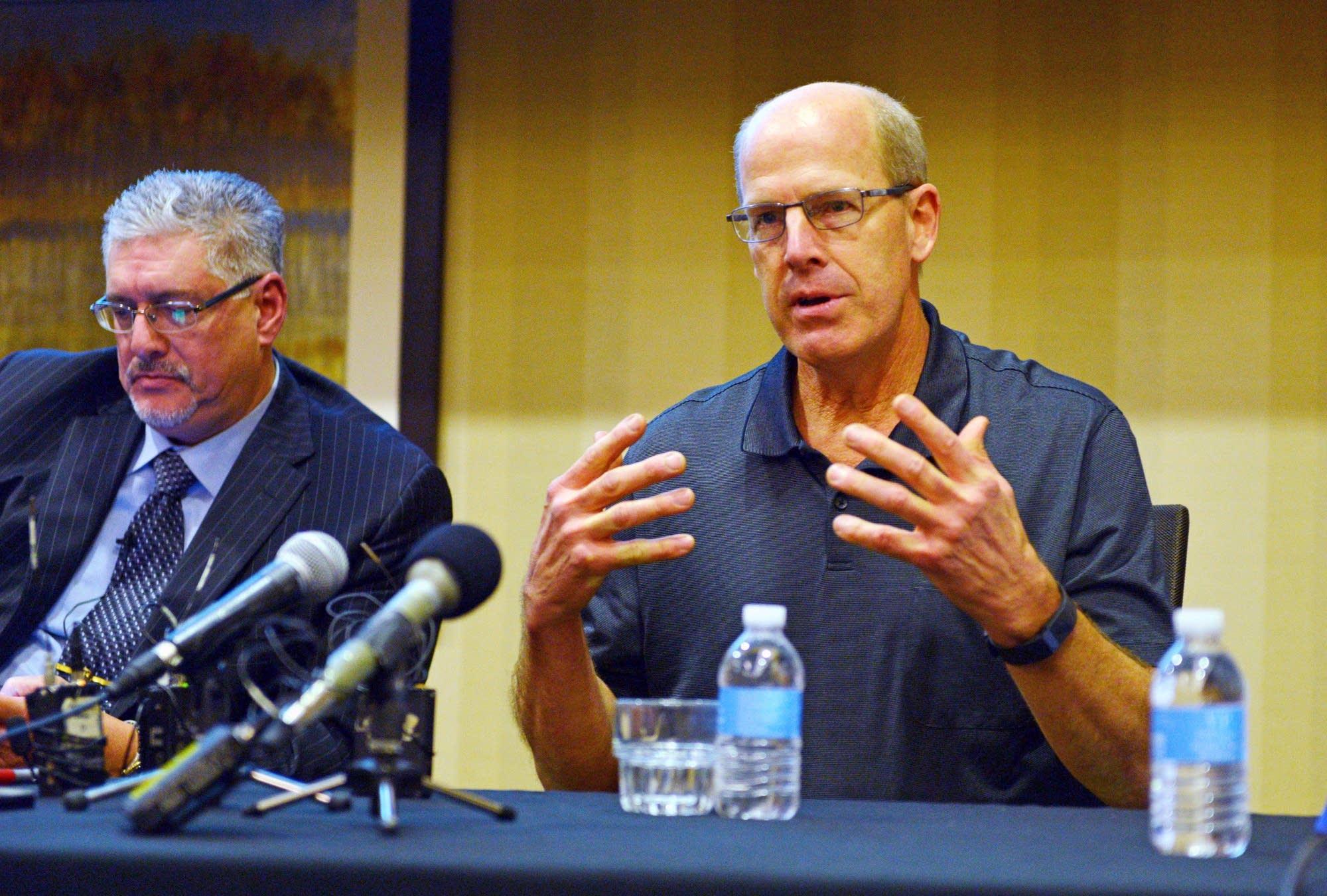 Daniel Rassier speaks at a press conference.