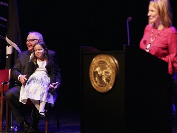 Gov. Tim Walz sits with Lt. Gov. Peggy Flanagan's daughter.