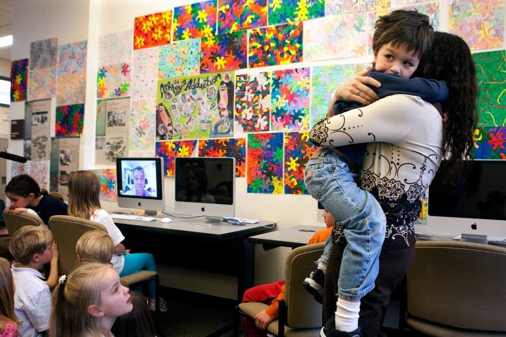 Peggy Pereda holds her son A.J. Pereda