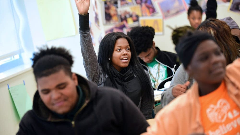 Domonique Crosby raises her hand in calculus class