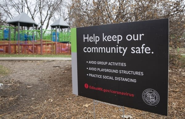 "A sign reads ""Help keep our community safe"""