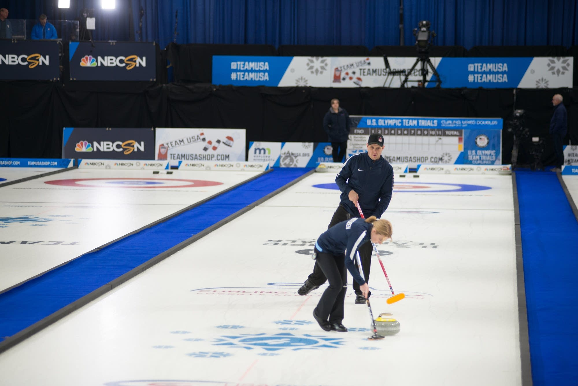 John Shuster guides as Cory Christenen sweeps during the finals.