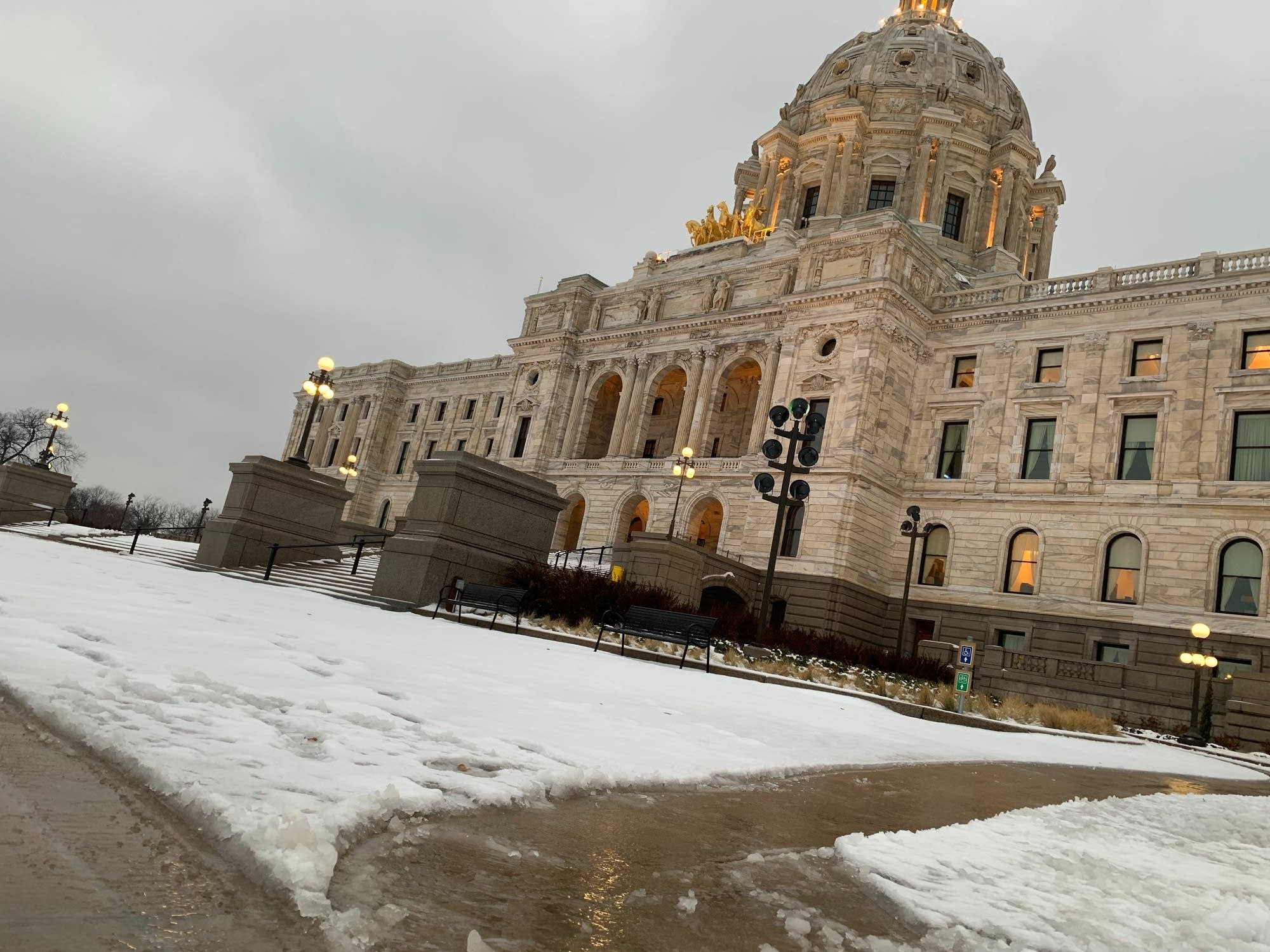 The grounds of the Minnesota State Capitol are covered in slushy, wet snow.