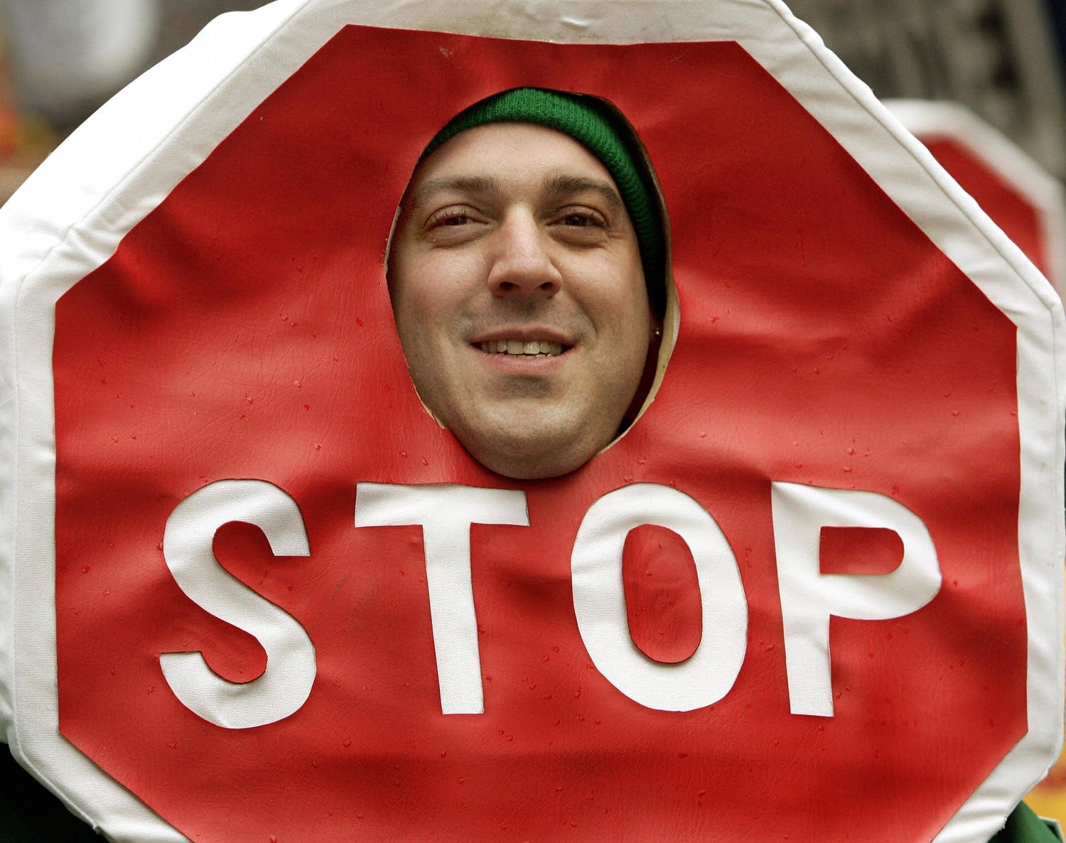 A parade marcher wearing a Stop Sign costume
