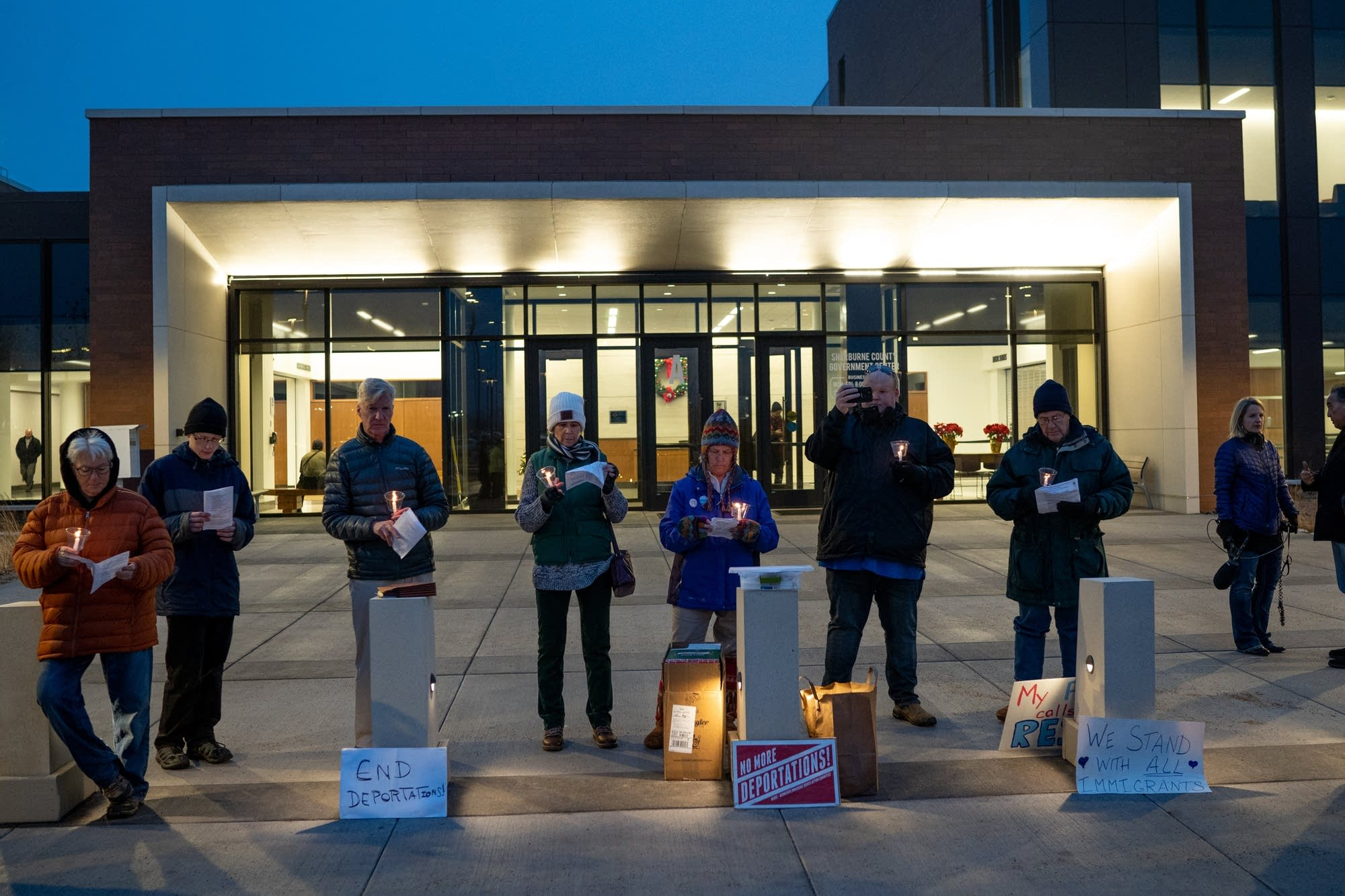 Protesters pray an sing hymns outside of the Sherburne County Jail.