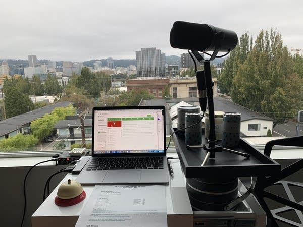 Laptop computer next to a precariously placed microphone in front of window