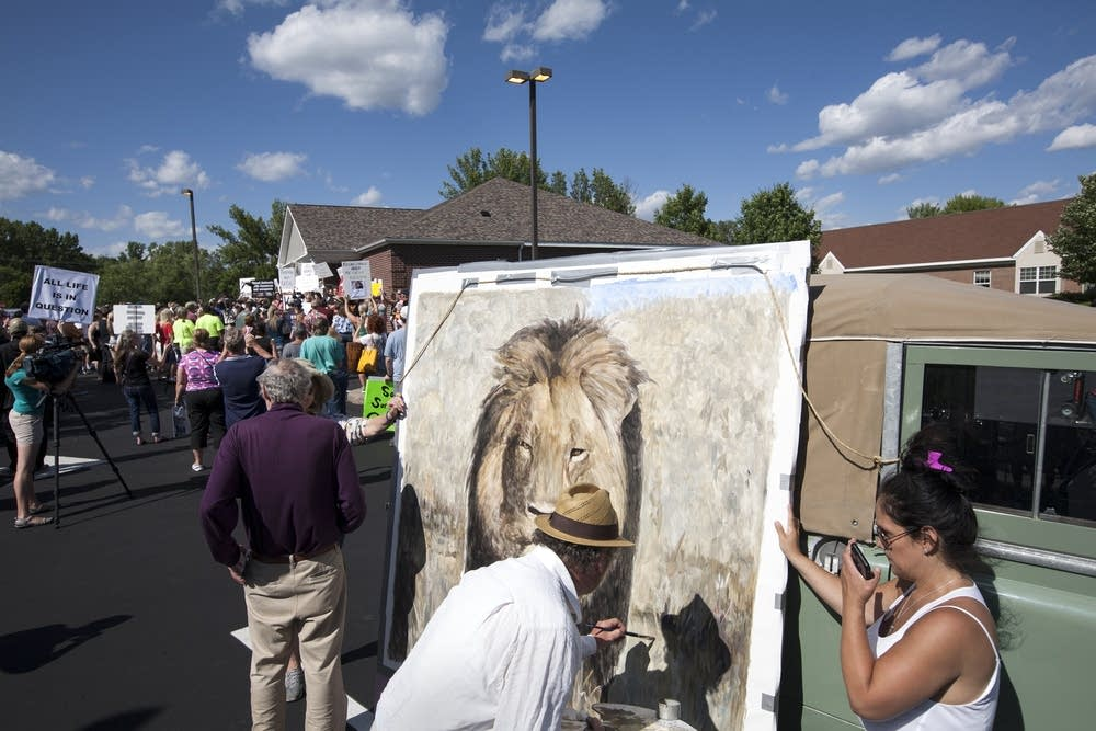 Artist Mark Balma painted during the protest.