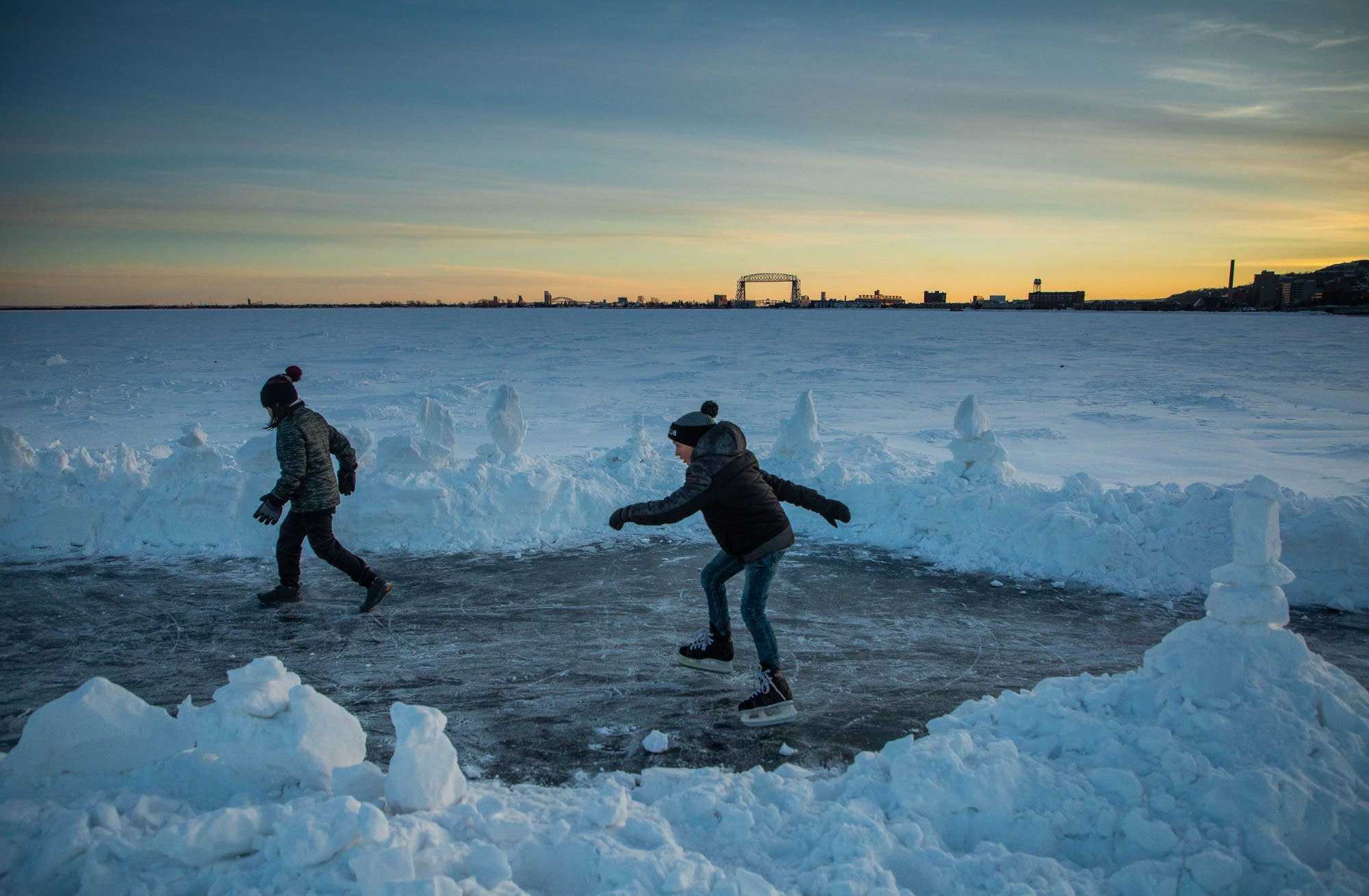 Ansel Cazier skates on Lake Superior with his friend George Belmore.