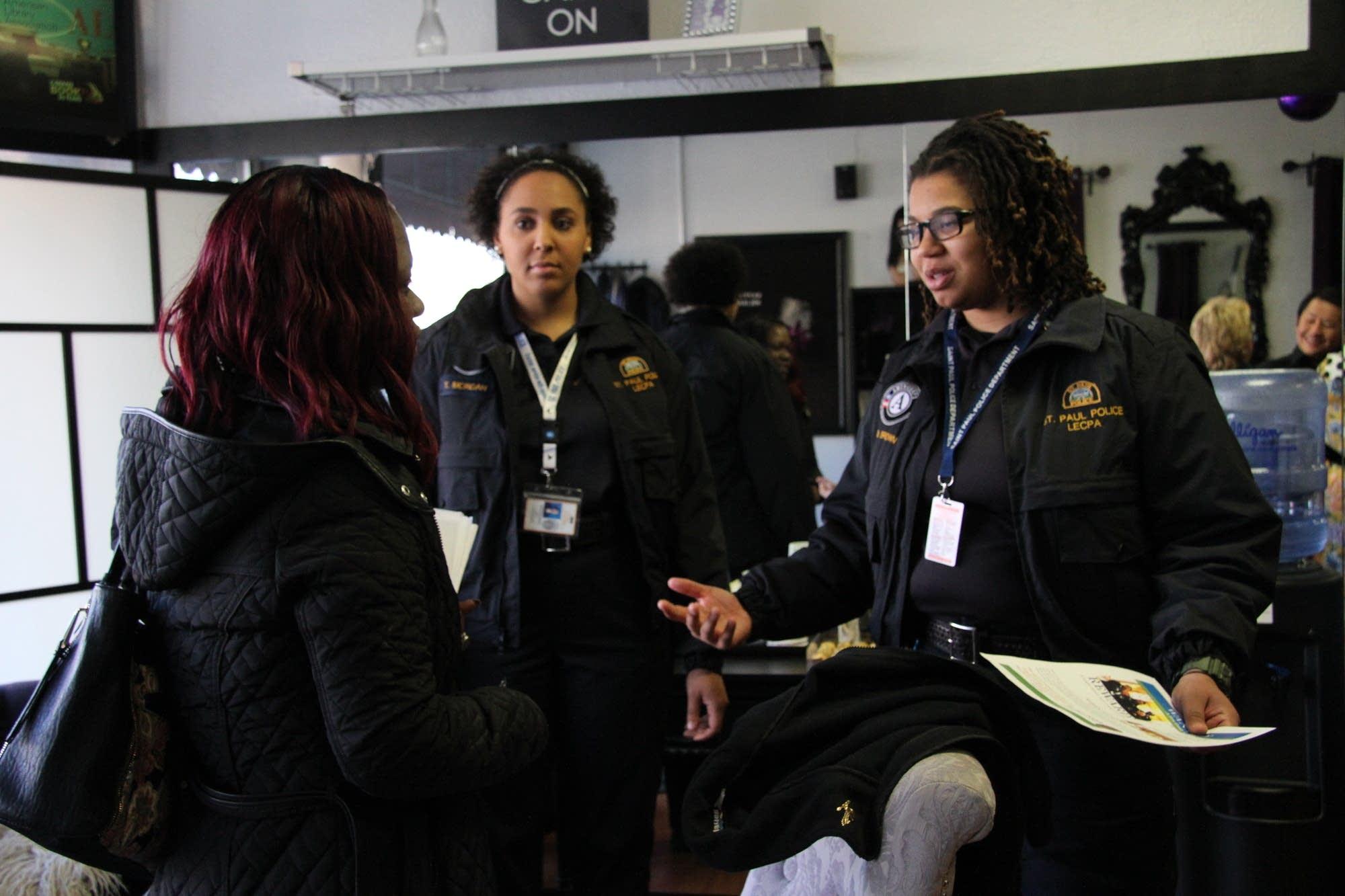 Rae Brown, left, and Tanisha Morgan chat with Khulia Pringle.