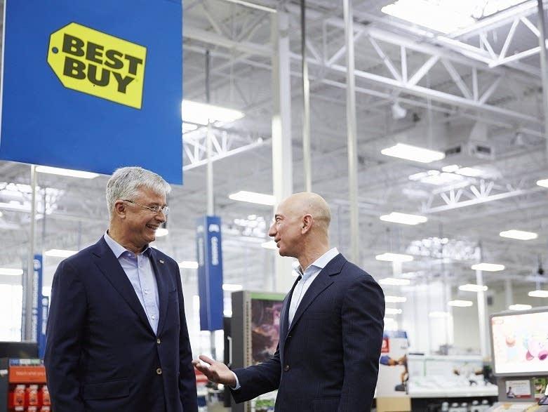 Hubert Joly, Best Buy chairman and Jeff Bezos, Amazon founder.