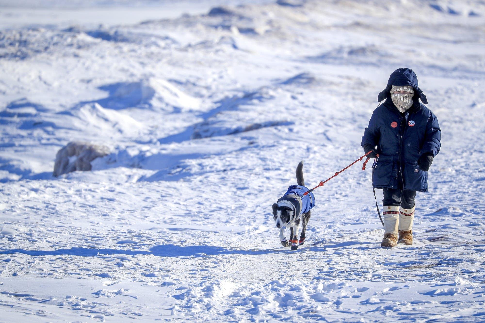 Helen Mongan-Rallis of Duluth walks her 9-year-old Border Collie, Peanut.