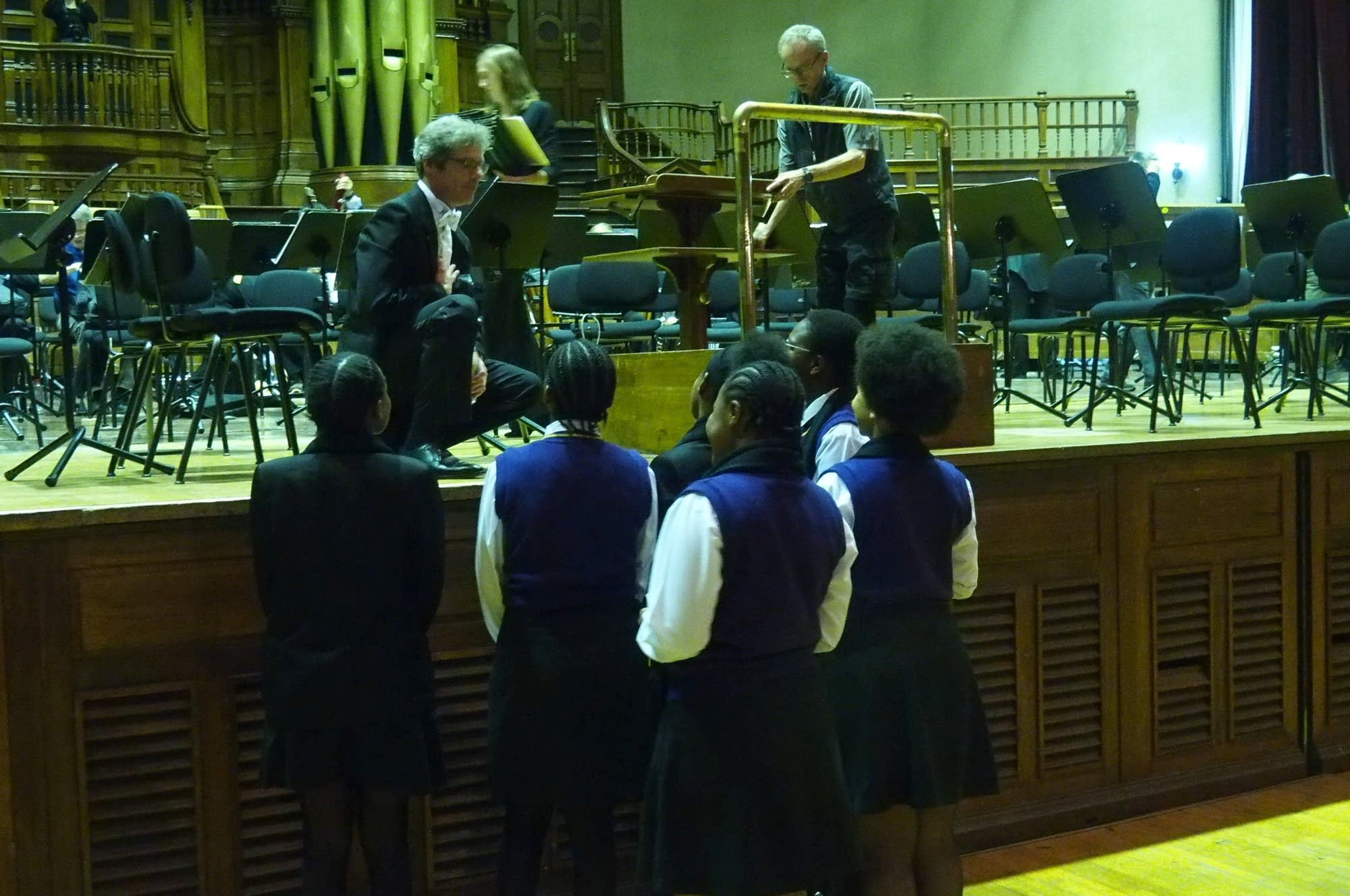Students from Inanda Seminar talk to flute player Adam Kunzel.