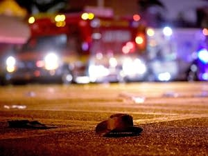 A cowboy hat lays in the street after shots were fired.