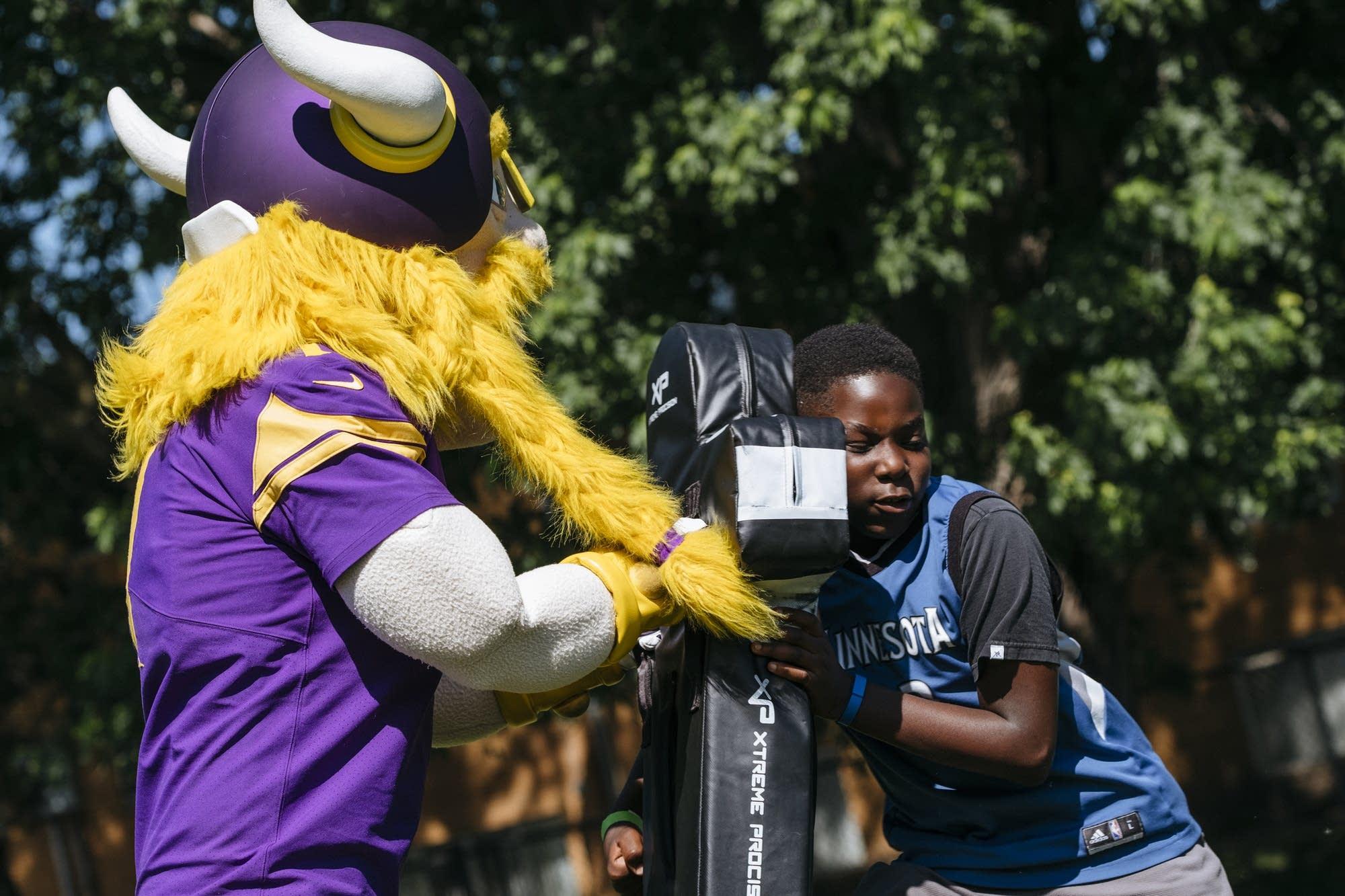 13-year-old Eric Aduda lays a hit on Viktor the Viking.