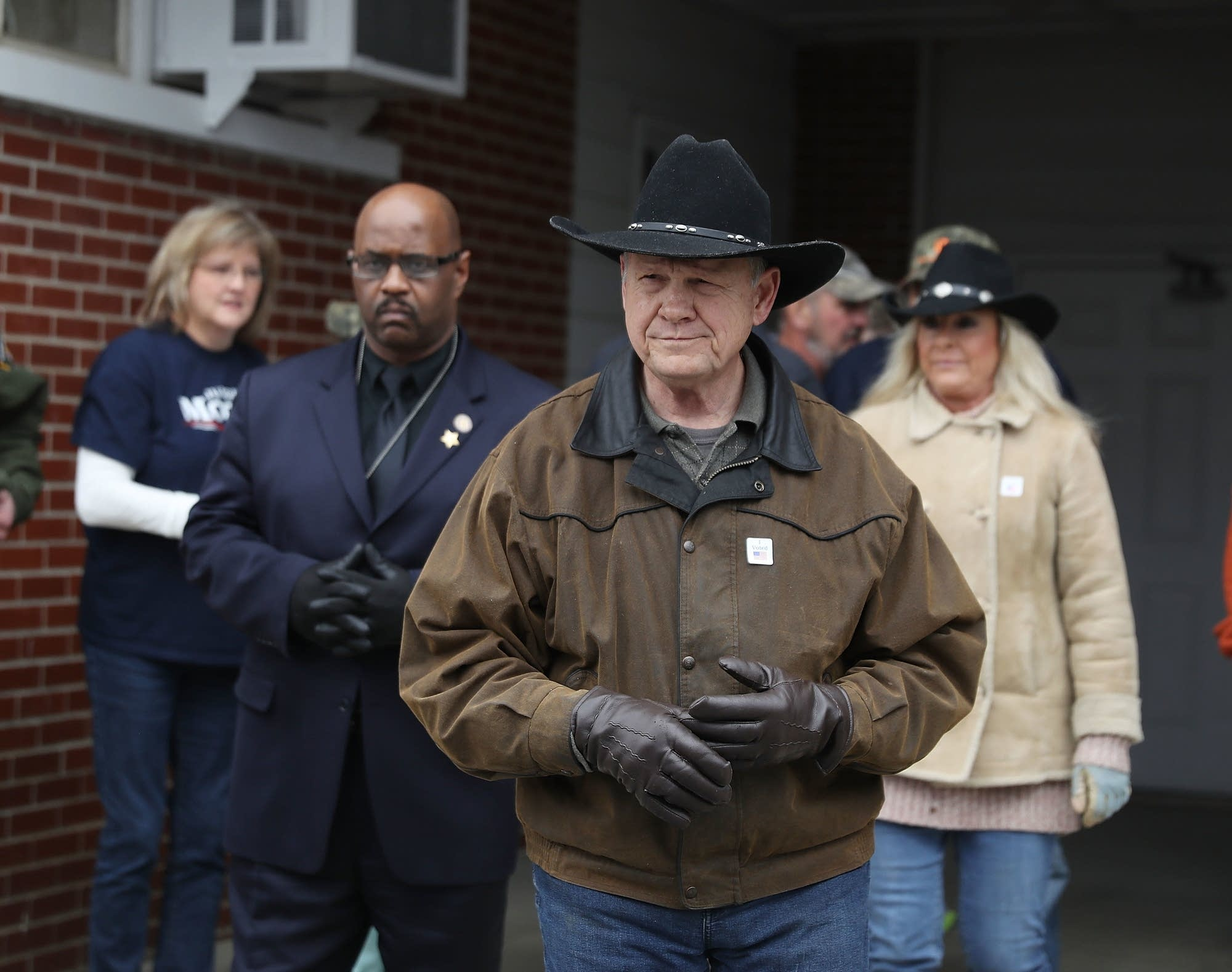 Republican Senatorial candidate Roy Moore exits after casting his vote