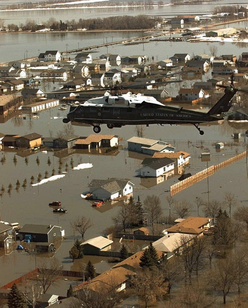 President Clinton's helicopter over flood damage