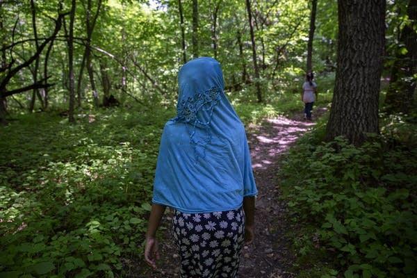 Hanan Samatar hikes on a trail at Sibley State Park.
